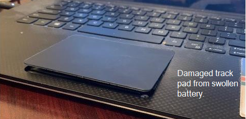 Image of track pad damaged by swollen battery